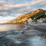 As the tide rushed in, the mountains of Amalfi Italy were engulfed in beautiful golden light.