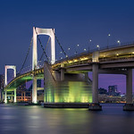A beautiful twilight view of the rainbow bridge in Tokyo Japan