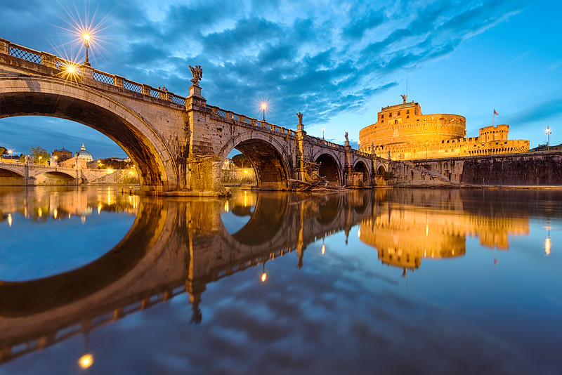 A perfect moment of beautiful cloudy twilight over Ponte Sant Angelo in Rome, Italy.
