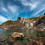 A warm sunny afternoon on the rocks overlooking the beautiful Riomaggiore, Italy.